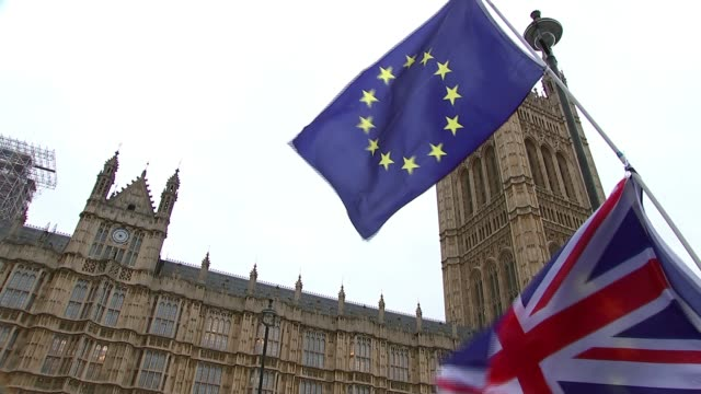 Northern Irish politicians visit Downing Street amid uncertainty over border and divorce bill Westminster EXT EU flag outside Parliament UK flag