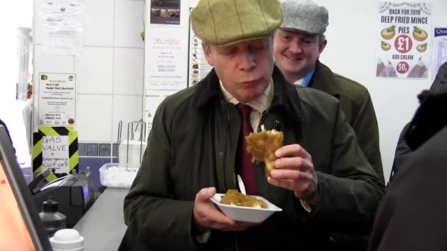 brexit party leader nigel farage visits doncaster market on the campaign trail. mr farage visits a fish and chip shop, a fish stall and an antique... - brexit party stock videos & royalty-free footage