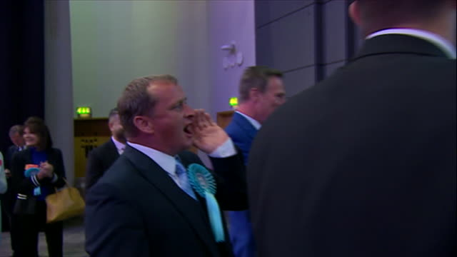 brexit party members booing and jeering a labour party candidate on stage during the european elections - brexit party stock videos & royalty-free footage