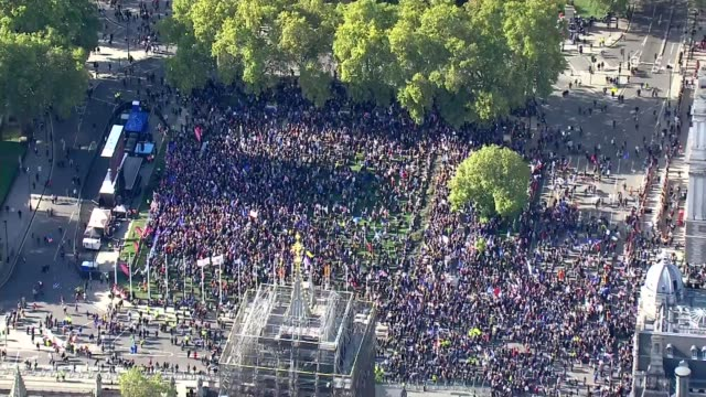 people's vote protest march through central london air views england london westminster crowd of protesters at parliament square / victoria tower... - victoria tower stock videos & royalty-free footage