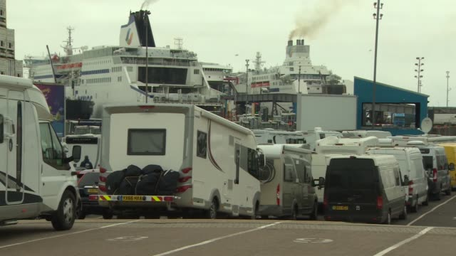 portsmouth international port views; england: hampshire: portsmouth: portsmouth international port: ext man walking dogs / various vehicles waiting... - ferry stock-videos und b-roll-filmmaterial