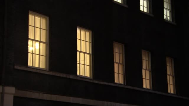 prime minister writing to eu to formally ask for june brexit postponement england london downing street focus windows with lights on wide shot number... - night stock videos & royalty-free footage