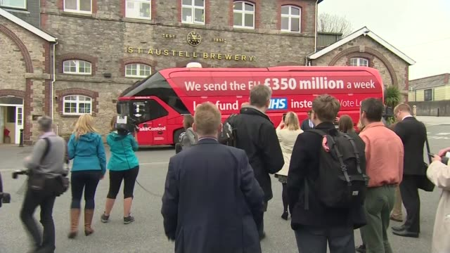 pro remain groups band together over damage to nhs lib / england cornwall st austell brewery ext 'vote leave' campaign bus along as arriving in... - boris johnson stock videos & royalty-free footage