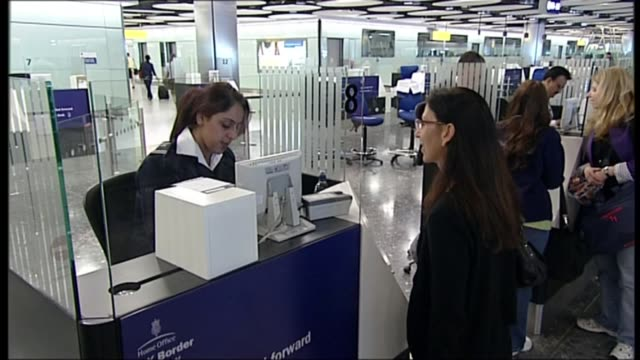 brexit prompts large full in net immigration figures; r14061001 heathrow airport: various of people at border agency counters having their passports... - checked pattern stock videos & royalty-free footage