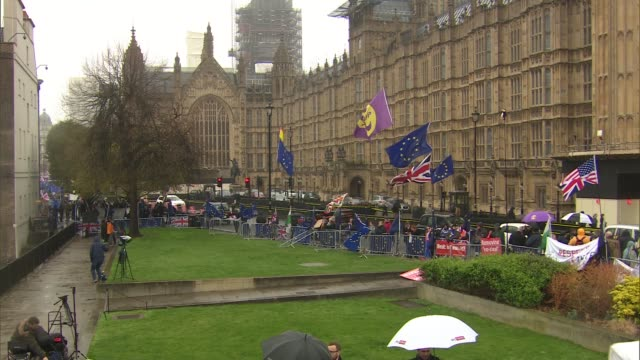 Protesters and flags outside Houses of Parliament as MPs prepare to vote on Theresa May's Brexit deal ENGLAND London Westminster Various of pro and...