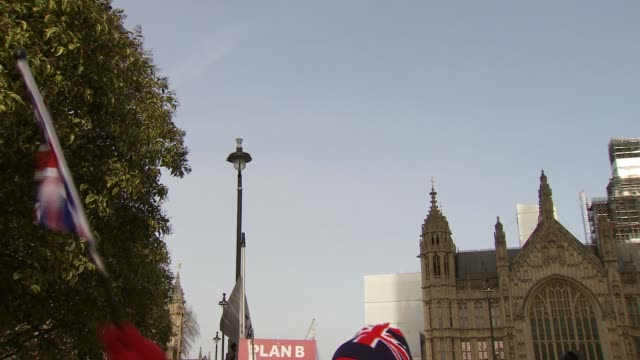 protesters outside houses of parliament england london westminster houses of parliament ext various shots of probrexit protesters / man wearing union... - tourism stock videos & royalty-free footage