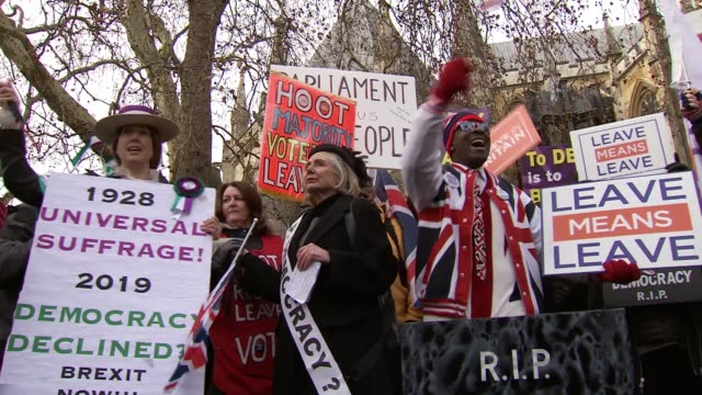 protesters outside houses of parliament england london westminster houses of parliament ext probrexit protesters placing mockedup gravestone 'rip... - protestor stock videos & royalty-free footage