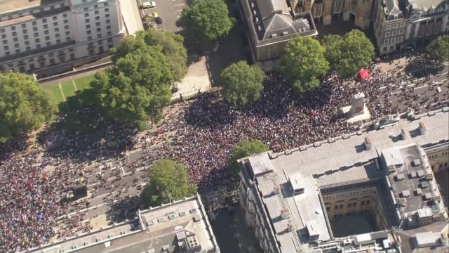 protests against the prorogation of parliament take place across the uk; england: london: whitehall ext air view protesters marching along road zoom... - marching stock videos & royalty-free footage