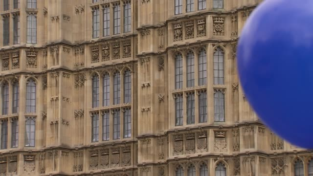 protests in westminster england london westminster ext flags including scottish and welsh flags / demonstrators / balloon with eu stars / protest... - victoria tower stock videos & royalty-free footage