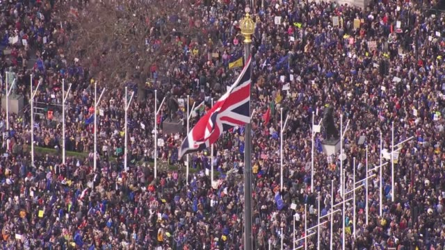 'put it to the people' march aerials england london people's vote rally in parliament square / union jack flag flying from victoria tower / crowd of... - flag stock videos & royalty-free footage