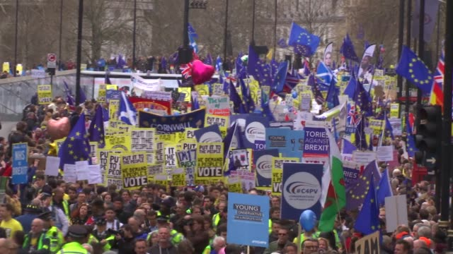 put it to the people march organisers say more than a million join demonstration england london ext wide shot crowd marching along with placards... - marching stock videos and b-roll footage