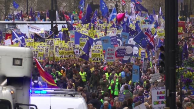 put it to the people march: organisers say more than a million join demonstration; england: london: whitehall: anti-brexit protesters along with eu... - brexit stock videos & royalty-free footage