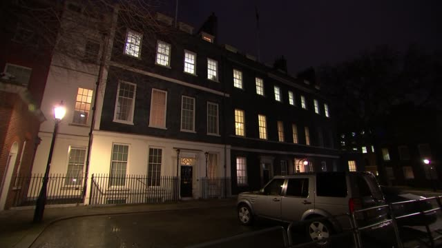 stockvideo's en b-roll-footage met response to theresa may's criticism of mps / mps receive threats england london downing street gv 10 and 11 downing street gvs front door and lit... - downing street