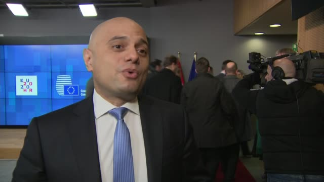 stockvideo's en b-roll-footage met sajid javid interview as arriving at ecofin belgium brussels int sajid javid mp arriving for the economic and financial affairs council and interview... - politics