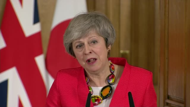shinzo abe calls for no deal to be avoided during uk visit; england: london: 10 downing street: int theresa may mp speaking at joint press conference... - 10 downing street stock videos & royalty-free footage