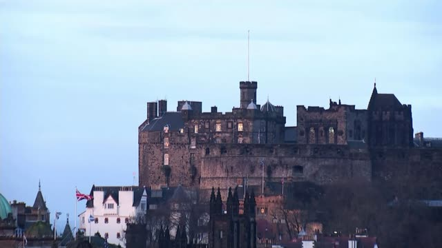 supreme court judgement: reactions; traffic along entrance to the scottish parliament building sign outside the parliament building eu flag, scottish... - scottish flag stock videos & royalty-free footage