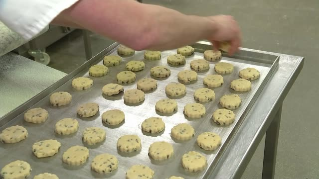 supreme court judgement reactions scotland edinburgh int workers wearing hygeine caps and masks operating machinery in biscuit factory shortbread cut... - biscuit stock videos & royalty-free footage