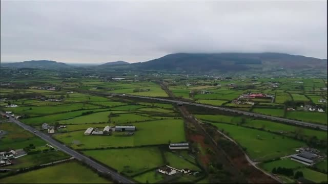 Democratic Unionists accused of preventing deal IRELAND / NORTHERN FOOTAGE fields around border between Republic of Ireland and Northern Ireland