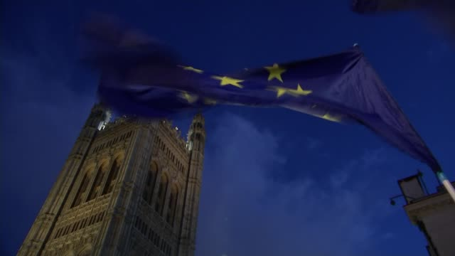 Tensions in Conservative Party over terms of the transition ENGLAND London Low angle shot of Houses of Parliament Victoria Tower with European Union...