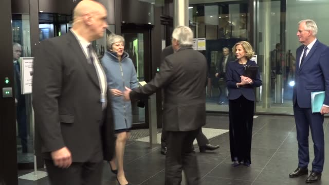 theresa may arrives in strasbourg; france: strasbourg: int gvs jean-claude juncker and michel barnier waiting for theresa may mp / may greets junker... - scrap yard stock videos & royalty-free footage