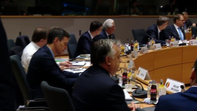 Theresa May at EU Summit meeting BELGIUM Brussels European Council INT Theresa May MP sat at table beside Donald Tusk at meeting