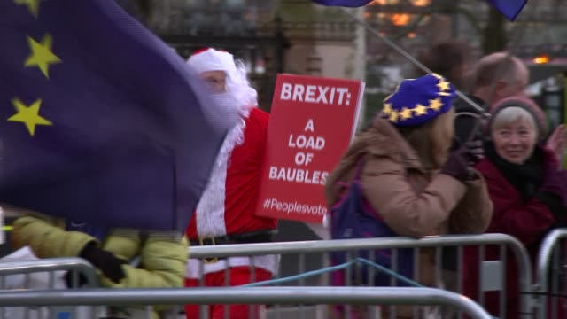 Theresa May delays Parliament's vote on her Brexit deal ENGLAND London Westminster AntiBrexit protesters outside the Houses of Parliament including...