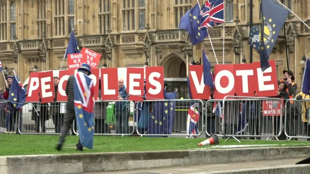 Theresa May delays Parliament's vote on her Brexit deal ENGLAND London Westminster EXT AntiBrexit protesters outside the Houses of Parliament holding...