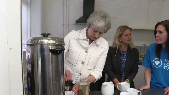 theresa may insists a deal with eu is 'achievable' england london int theresa may mp taking hot water from tea urn close shot may looking in tea urn... - decorative urn stock videos and b-roll footage