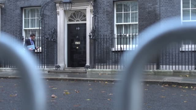 Theresa May insists she will not sign deal 'at any cost' as chances of November ENGLAND London Downing Street Downing Street with crowd barriers in...