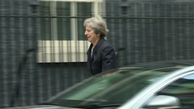 Theresa May makes statement to Commons on Brexit talks ENGLAND London Downing Street EXT Theresa May MP from car and into Number 10 ignoring unseen...