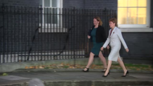 theresa may meets with nicola sturgeon; england: london: downing street: ext evening scotland first minister nicola sturgeon msp along and greeted by... - member of the scottish parliament stock videos & royalty-free footage