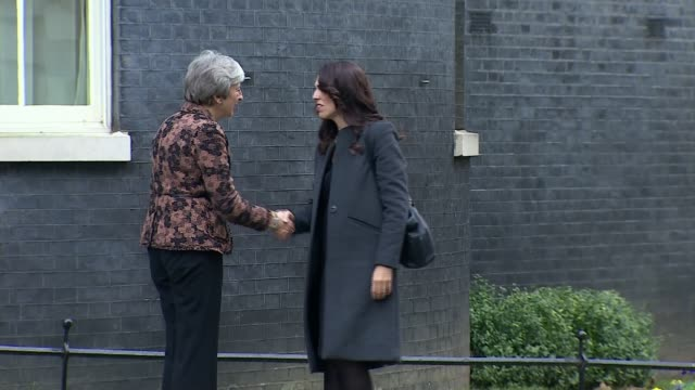 theresa may outlines brexit 'plan b' in statement to house of commons; england: london: downing street: ext theresa may mp along and shaking hands... - notfallplan konzepte stock-videos und b-roll-filmmaterial