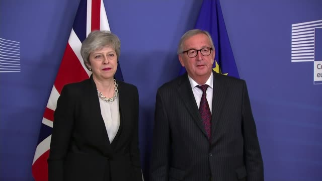 theresa may returns to brussels for talks with jeanclaude juncker belgium brussels berlaymont building int theresa may mp and jeanclaude juncker... - theresa may stock videos & royalty-free footage