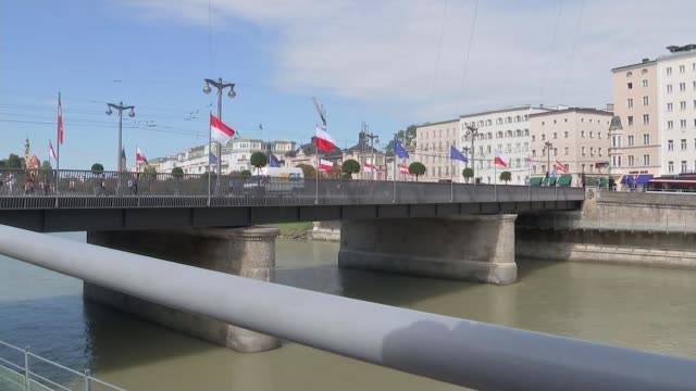 theresa may seeks support for her chequers plan at informal eu summit in salzburg; austria: salzburg: ext wide shot of traffic along bridge lined by... - traditionally austrian stock videos & royalty-free footage