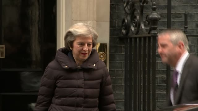 theresa may to make speech next week england london downing street ext theresa may mp from number 10 and into car part - number 10 stock videos & royalty-free footage