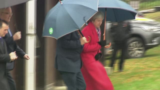 theresa may tours regions to promote brexit deal wales powys builth wells theresa may opening umbrella as along departing with alun cairns - powys stock videos & royalty-free footage