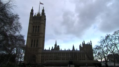 stockvideo's en b-roll-footage met theresa may urges mps to back her brexit deal ahead of crucial vote; england: london: houses of parliament: ext silhouette of houses of parliament... - victoria tower