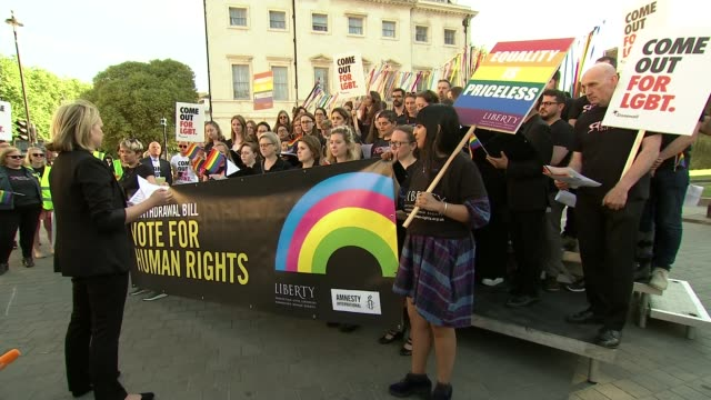 theresa may warns tory rebels over eu withdrawal bill england london westminster parliament square ext various shots lgbt choir singing as holding... - amnesty international stock videos & royalty-free footage