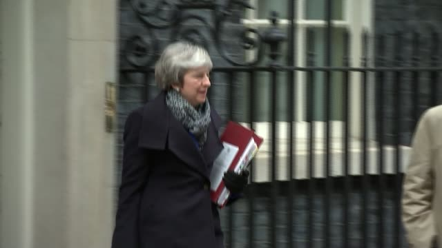 Theresa May wins vote of no confidence ENGLAND London Downing Street EXT Various of Theresa May MP from Number 10 to car Motorcade of May away