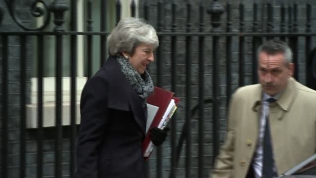 Theresa May wins vote of no confidence ENGLAND London Downing Street EXT Theresa May MP from Number 10 to car Motorcade of May away