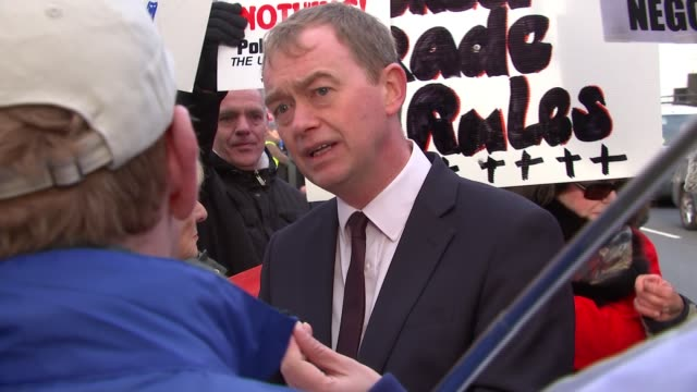 tim farron chatting with protesters outside parliament; england: london: westminster: ext tim farron mp chatting with protesters outside the houses... - bell stock videos & royalty-free footage