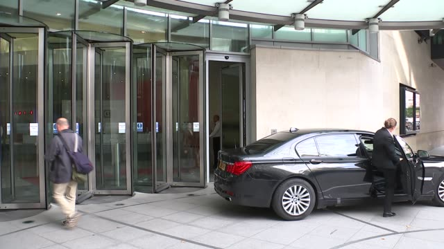 Tony Blair and Michael Fallon depart Broadcasting House ENGLAND London BBC Broadcasting House EXT Tony Blair from BBC building and then into car and...