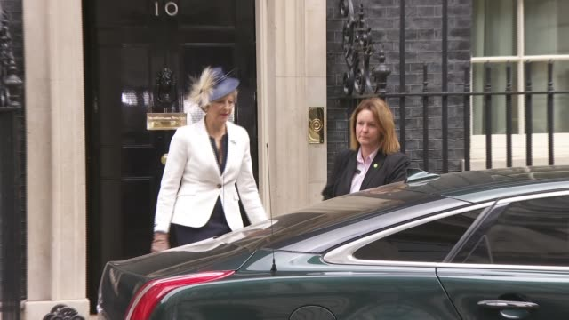 stockvideo's en b-roll-footage met two conservative vicechairs resign as may holds meeting of new cabinet and meets with merkel england london downing street ext theresa may mp from... - prime minister