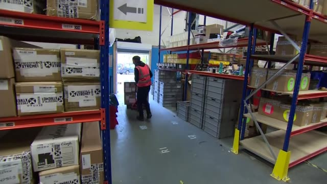 UK business leaders respond to threat of no deal ENGLAND Bristol INT Various shots people at work in warehouse moving boxes Shaun Loughlin interview...