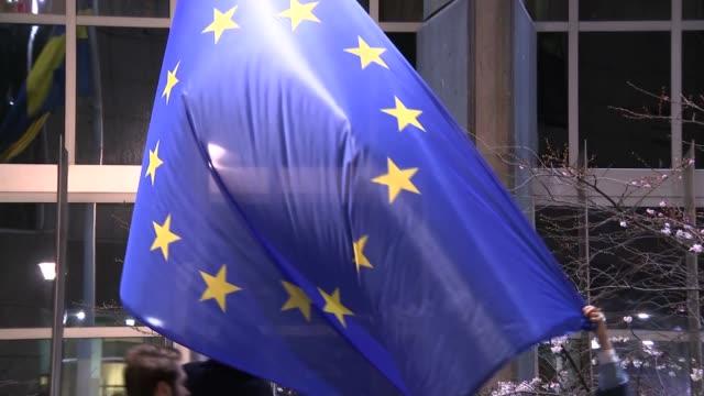 uk flag taken down outside european parliament belgium brussels european parliament eu flag being put up / uk flag folded / flag taken away - folded stock videos & royalty-free footage