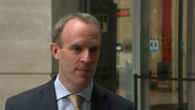 in 'last leg of negotiations' over trade deal; england: london: bbc new broadcasting house: ext dominic raab mp interview sot / raab away - politics点の映像素材/bロール
