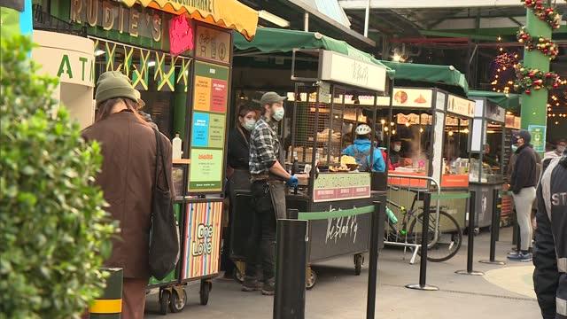 stockvideo's en b-roll-footage met trade deal negotiators return to brussels; england: london: borough market: general views of market and market traders - politics