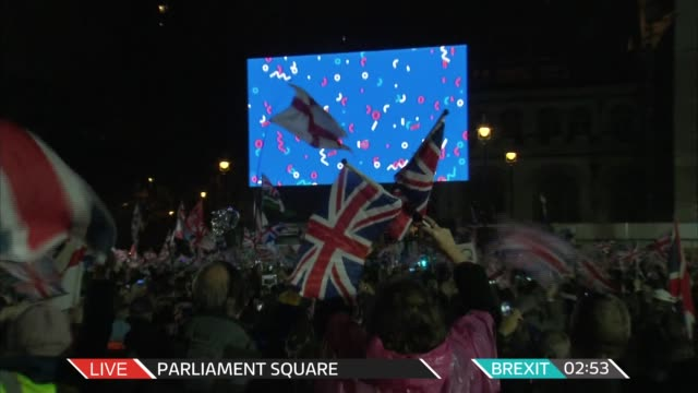 united kingdom leaves the european union: itv news brexit live special; england: london: westminster: parliament square: ext / night live crowd and... - brexit stock videos & royalty-free footage