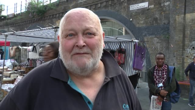 views from rainham and brixton england london lambeth brixton ext vox pops brixton station sign people along at street market vox pops various shots... - report stock videos & royalty-free footage