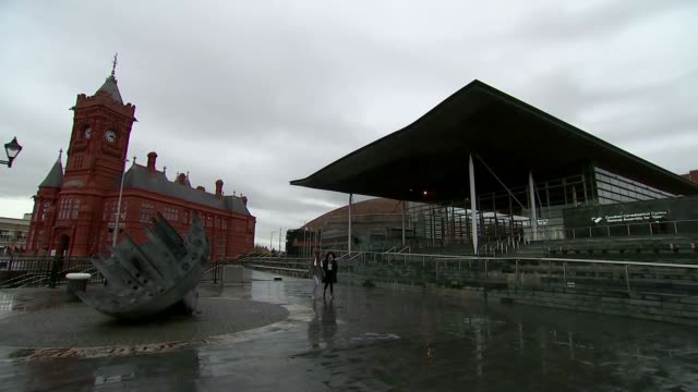 welsh assembly clears schedule to discuss nodeal brexit wales cardiff people along by sculpture and the senedd - cardiff wales stock videos & royalty-free footage